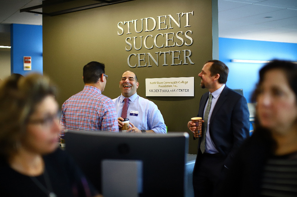 Men standing in Student Support and Success Center